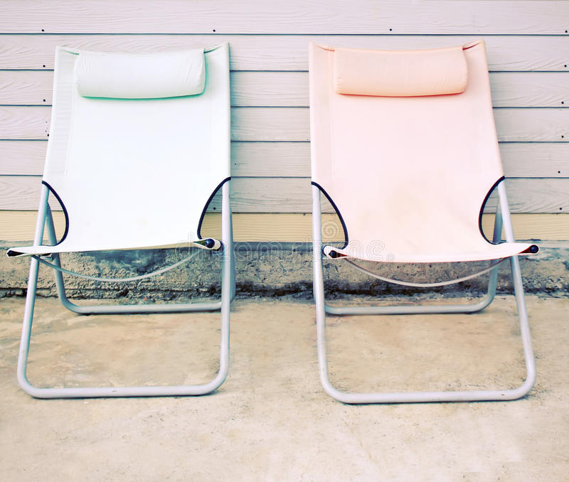 Two beach bench in front of the house royalty free stock photo