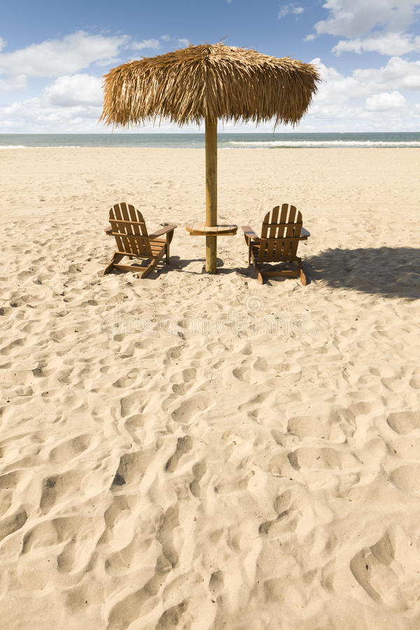 Download Two Beach Chairs And Umbrella On Beautiful Ocean Sand Royalty Free Stock Images - Image: 23779069
