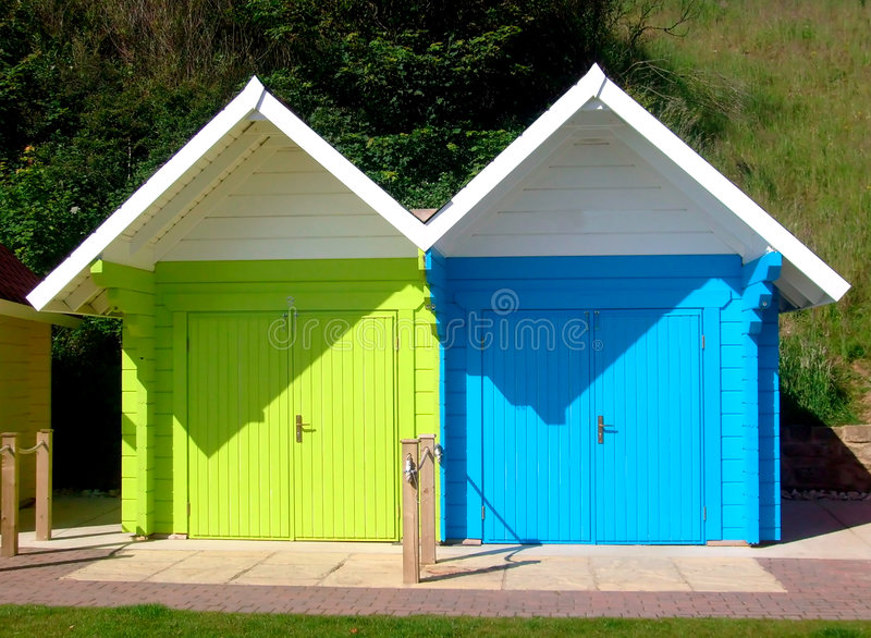 Two beach chalets. Colorful beach chalets by seaside, Scarborough North Bay, England, U.K stock images