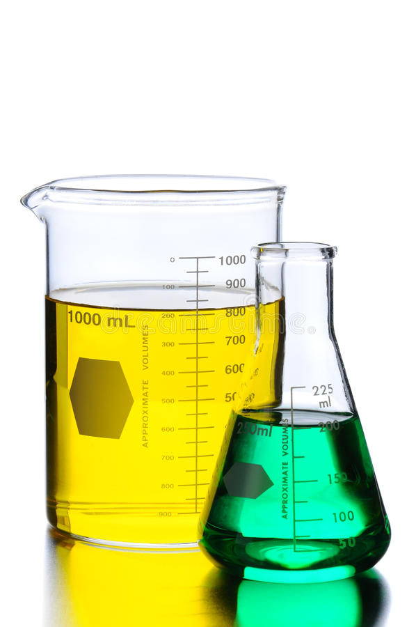 Two Beakers With Green And Yellow Liquids Stock Photos