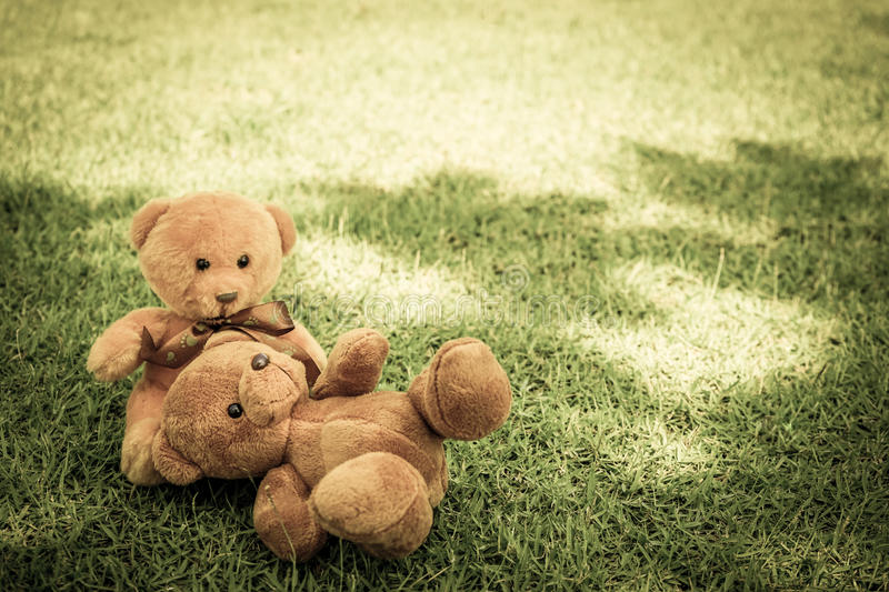Two Bear dolls. On the ground with old tone stock photo