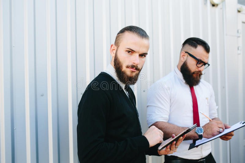 Two bearded businessman looking at something royalty free stock photography