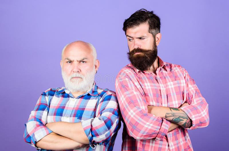 Two bearded men senior and mature. barbershop and hairdresser salon. father and son family. generational conflict. male. Beard care. checkered fashion. youth vs royalty free stock images