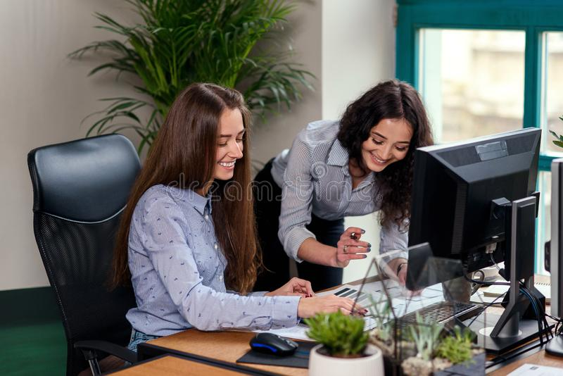 Two beatiful female architects working with progect at modern office. royalty free stock image