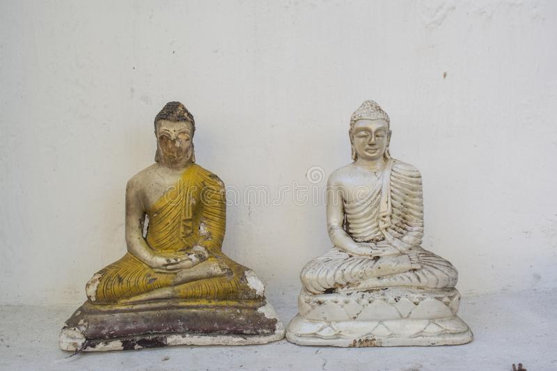 Two beautiful ancient buddhist statues at the altar in the temple royalty free stock photo