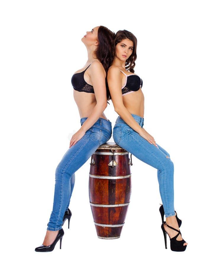 Two beautiful berunette women stock photos