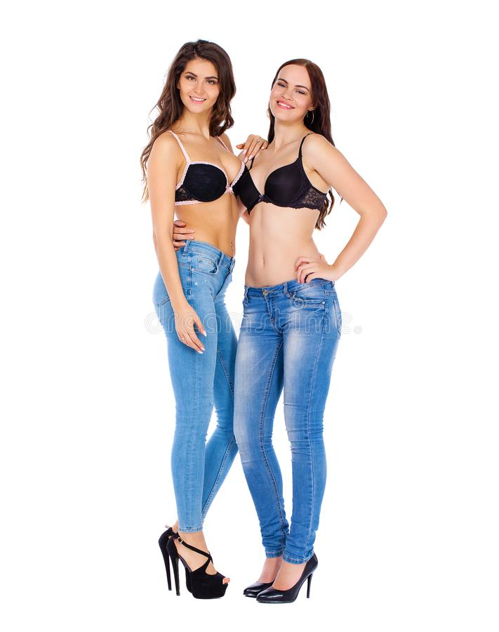 Two beautiful berunette women stock image