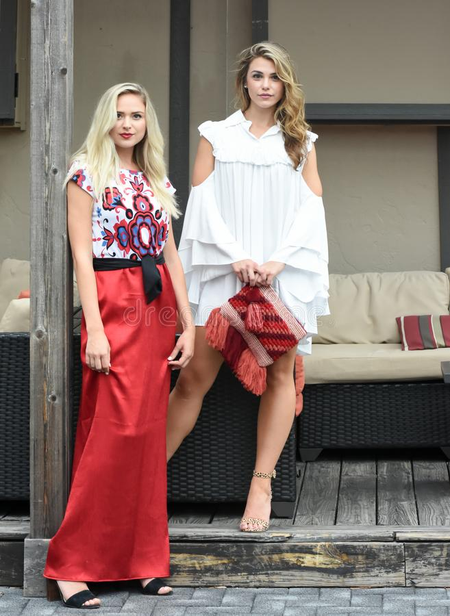 Two Beautiful Blonde Fashion Models During a Photoshoot stock images