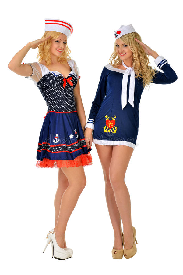 Two beautiful blonde women in carnival costumes. Two beautiful women in carnival costumes of seaman. Isolated image stock photos