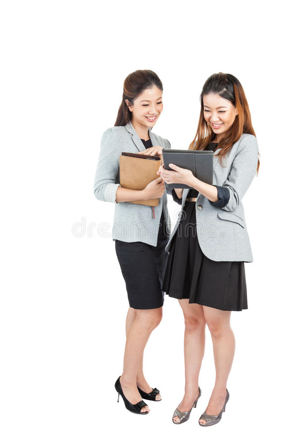 Two beautiful businesswomen working stock photo