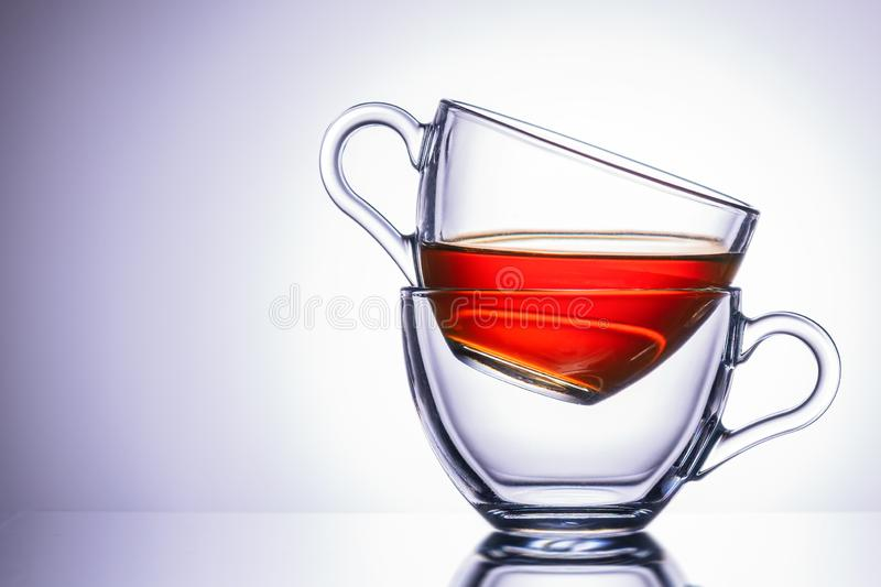 Two transparent mugs of tea. location on the right, close-up. stock photos