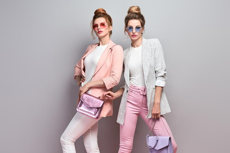 Two Fashion woman having fun, Trendy summer outfit royalty free stock photography
