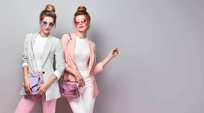 Two Fashion autumn woman, Trendy hair, fall outfit stock photography