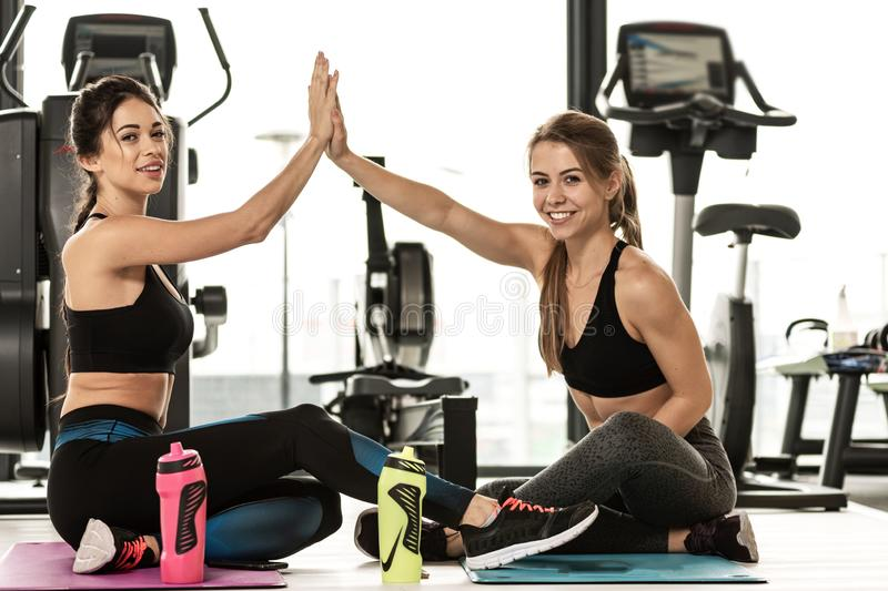 Fitness girls at the gym stock images