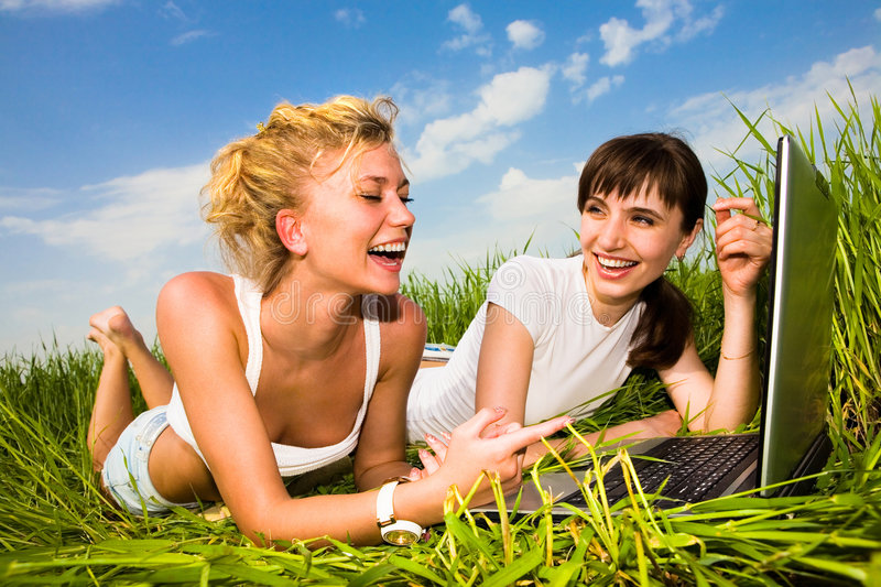 Download Two Beautiful Girl On A Laptop Computer Outdoors Stock Image - Image of garden, relaxed: 5642999