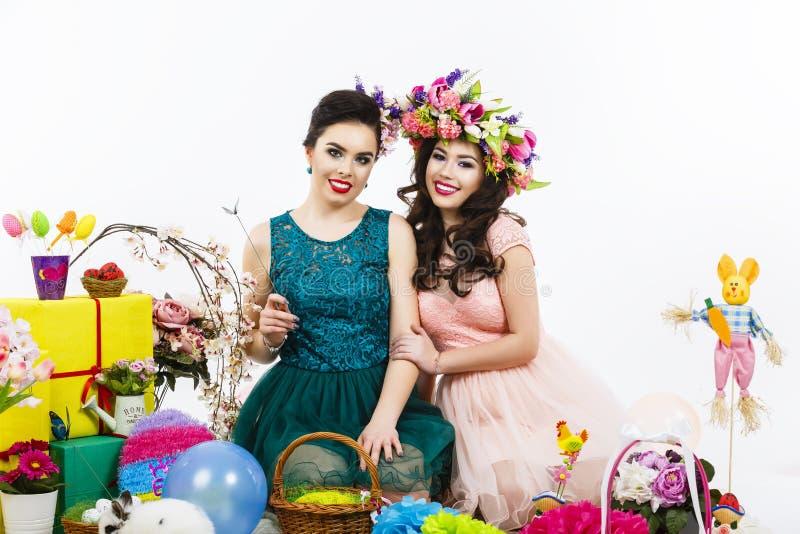 Two beautiful girlfriend girls basket with eggs and flower deco download two beautiful girlfriend girls basket with eggs and flower deco stock photo image negle Images