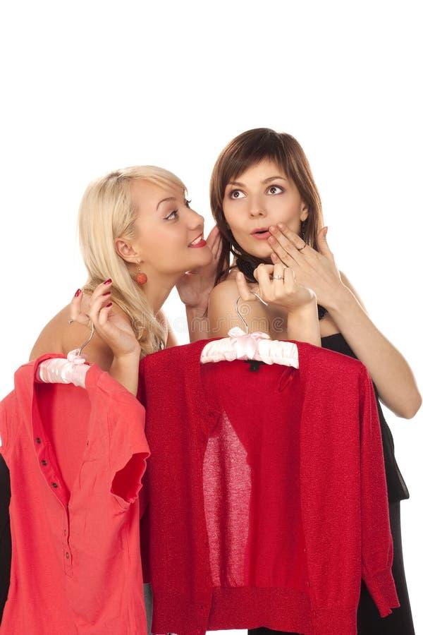 Two beautiful girlfriends on shopping