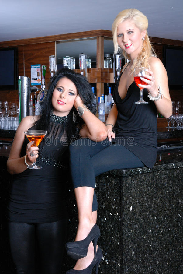 Download Two beautiful girls in bar stock photo. Image of seats - 16554680