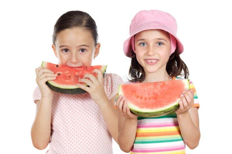 Two beautiful girls eating watermelon