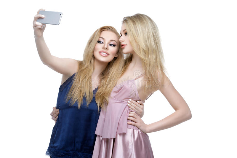 Two beautiful girls making selfie royalty free stock images