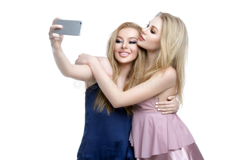 Two beautiful girls making selfie royalty free stock photo