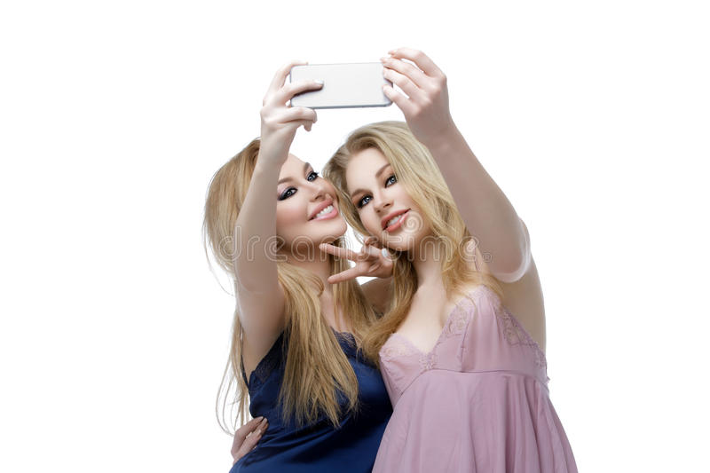 Two beautiful girls making selfie stock image