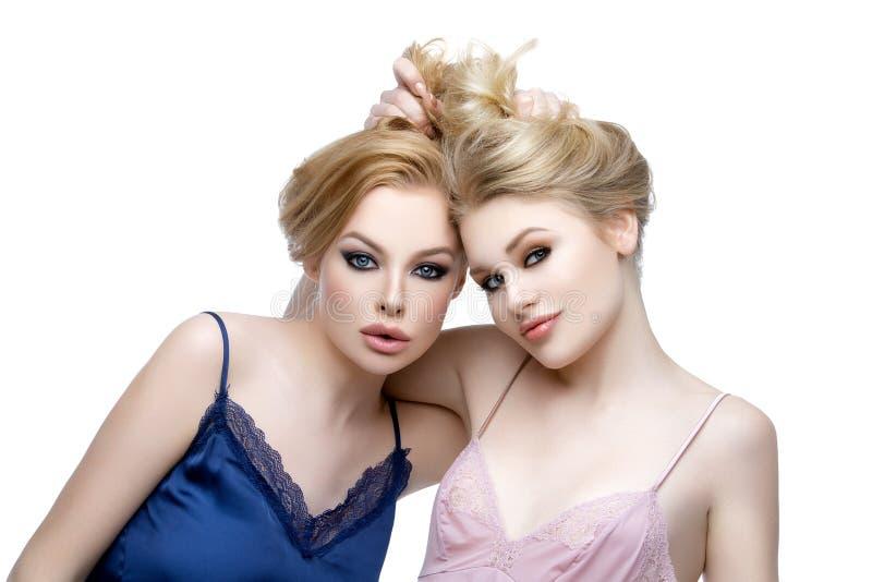 Two beautiful girls in night wear stock photo