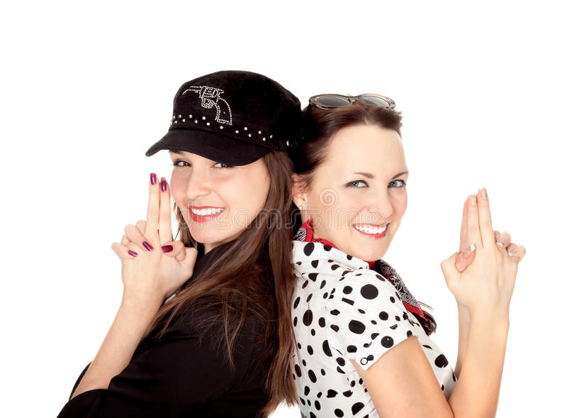 Two beautiful girls portrayed gangsters. Isolated on white royalty free stock photography