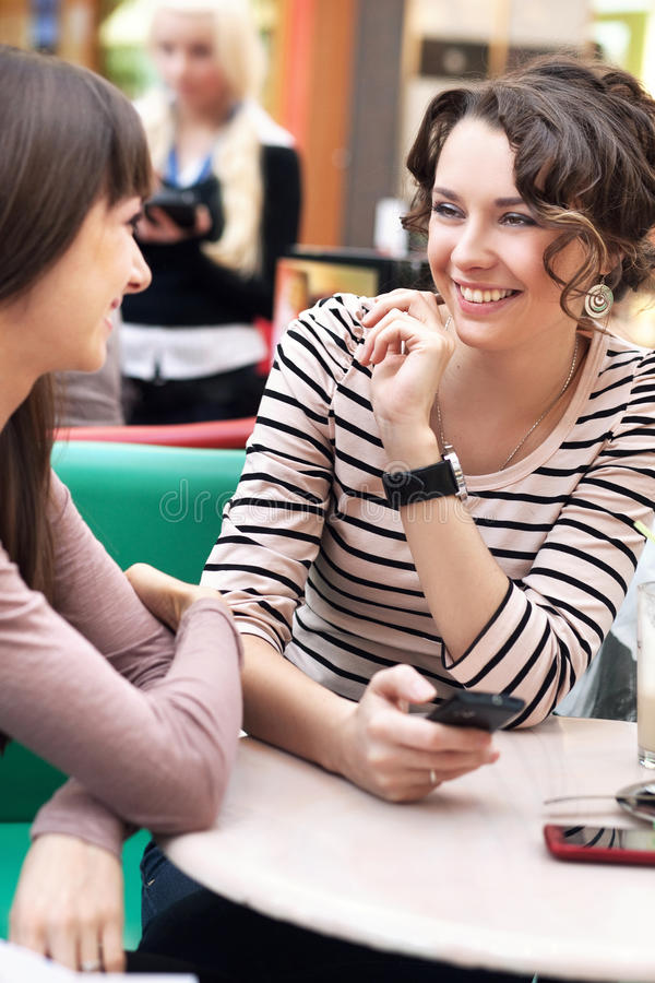 Two beautiful girls smiling stock photography