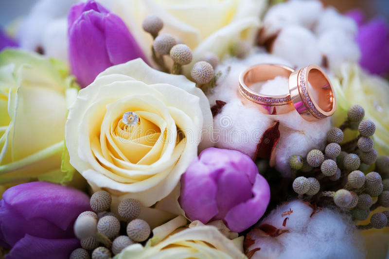 Two beautiful golden rings on the wedding boquet. Beautiful golden rings on the wedding boquet royalty free stock photo