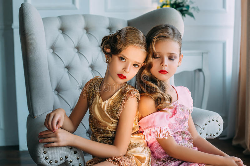 Two beautiful little girls in vintage style royalty free stock photography
