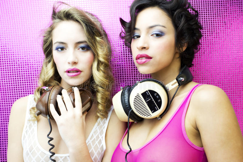 Two beautiful disco women stock images