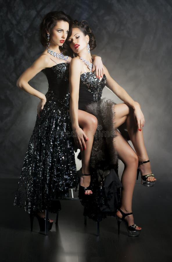 Two beautiful lesbian women flirting stock photo