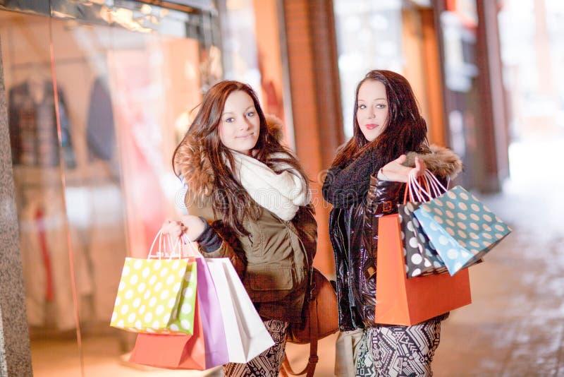 Beautiful young woman shoppers stock photos