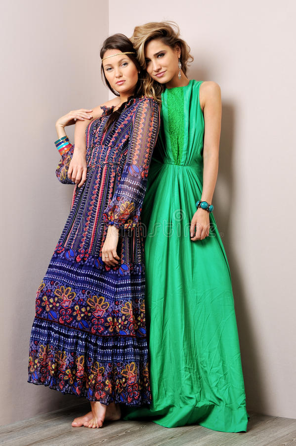 Two beautiful woman posing in a fancy dresses. Two beautiful women posing in a fancy dresses. Sudoi shooting royalty free stock photography