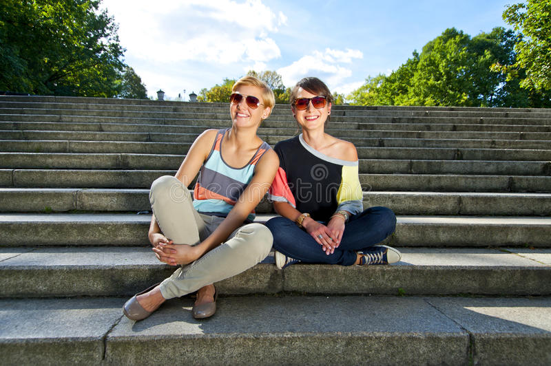 Download Two  Beautiful Woman With Sunglasses On The Stairs Stock Image - Image: 27587911