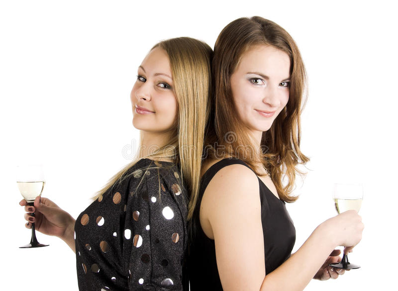 Two beautiful woman with wine glass royalty free stock images
