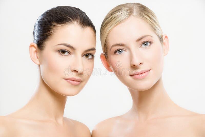 Two beautiful women royalty free stock photos