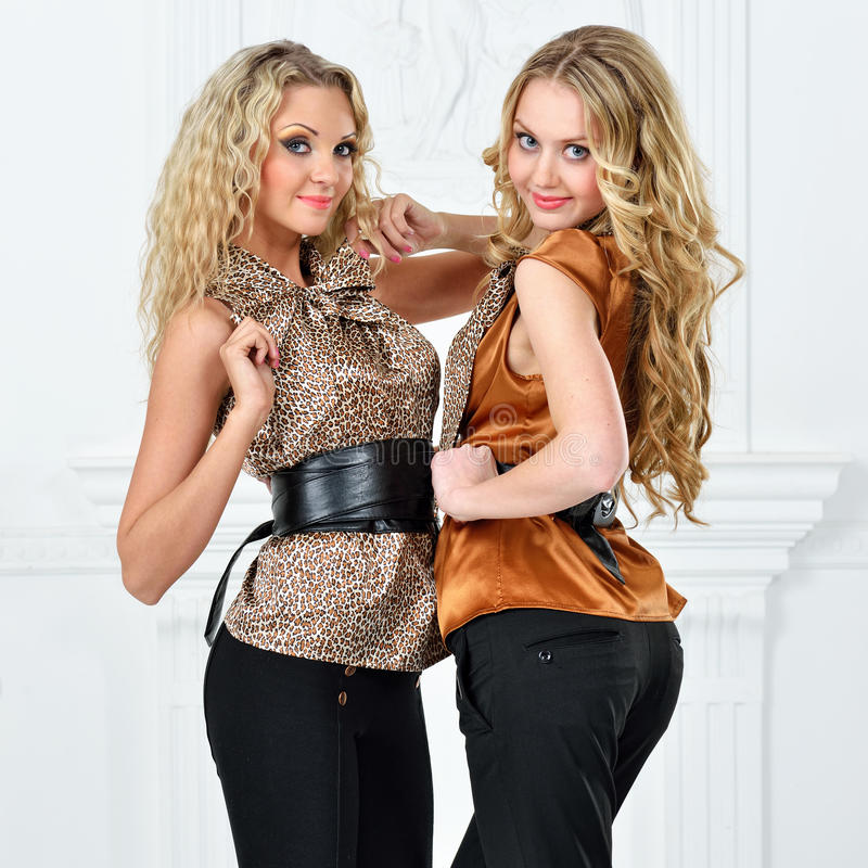 Two beautiful women in elegant evening suit. royalty free stock photo