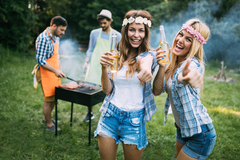 Two beautiful women having fun while waiting for barbecue stock photography