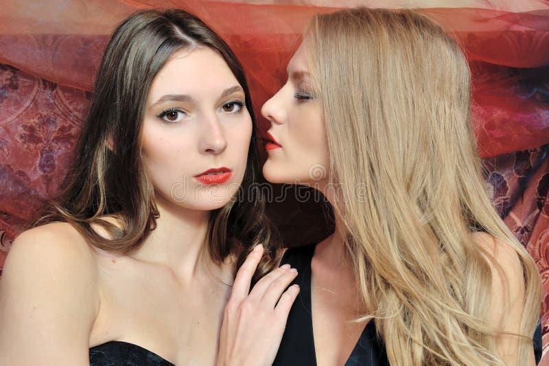 Two beautiful women in oriental interior stock photos
