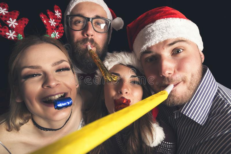 Blowing party whistles royalty free stock images