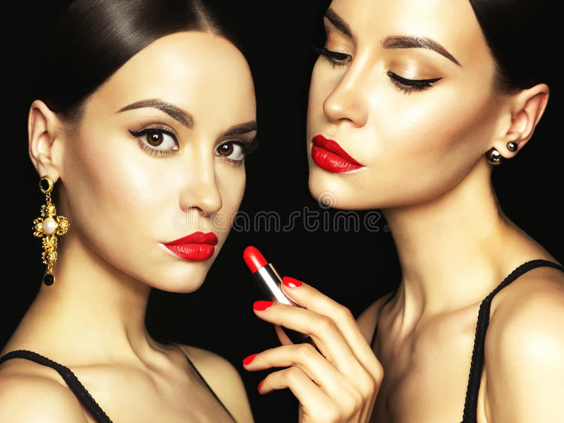 Two beautiful young ladies with red lipstick royalty free stock photos