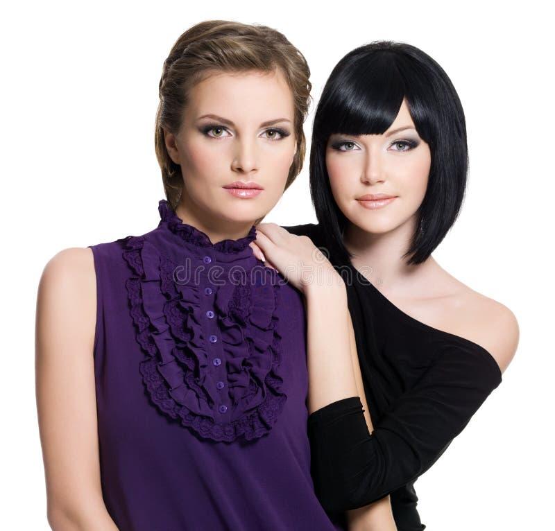 Two beautiful young sensual glamour women stock photos