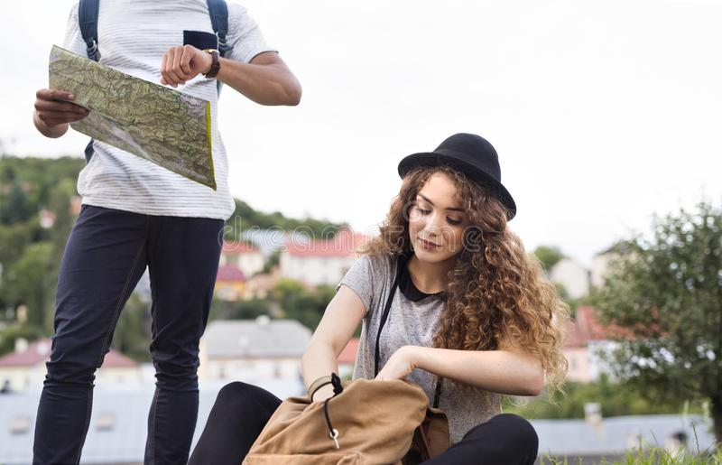 Two young tourists with map in the old town. stock image
