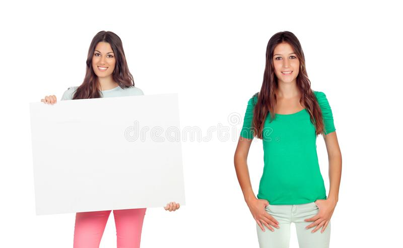 Two beautiful young woman and one of their holding a poster stock image