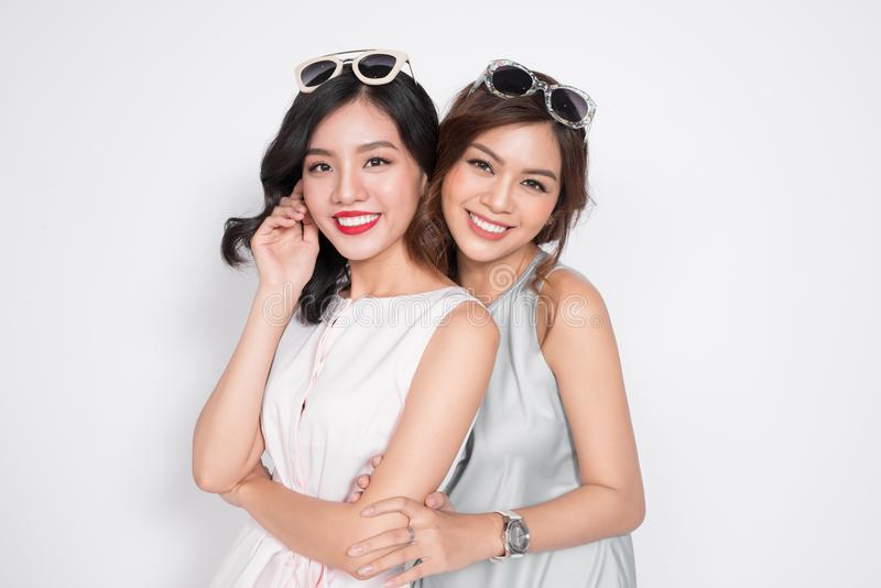 Two beautiful young women hugging and looking to camera. Two beautiful young women hugging and looking to camera stock images