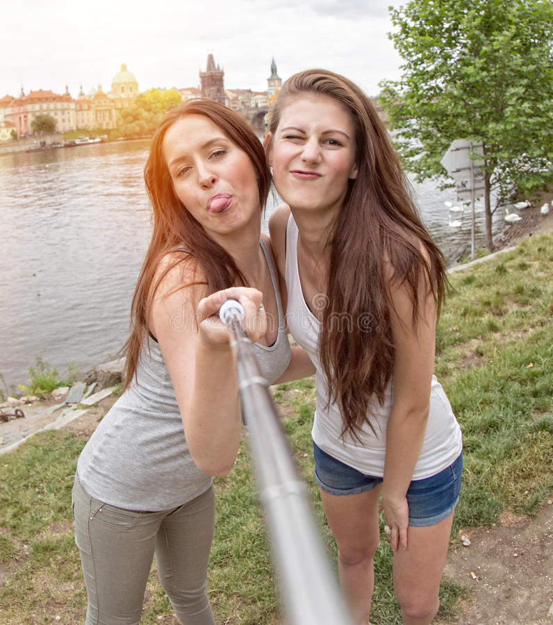 Two beautiful young women making selfie. In the city royalty free stock photos