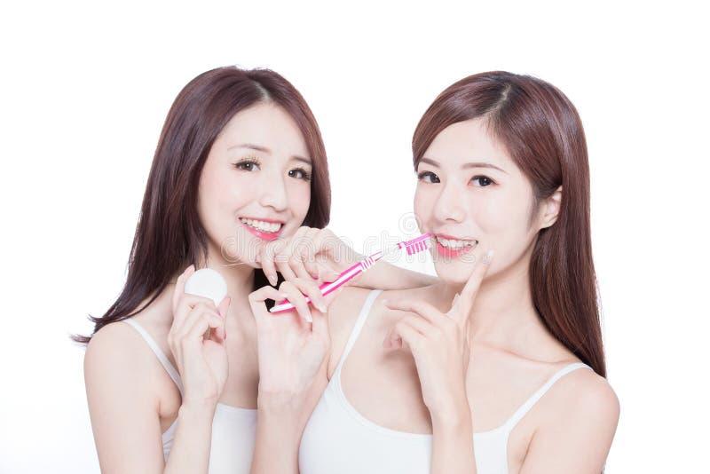 Two beauty women take brush stock photo