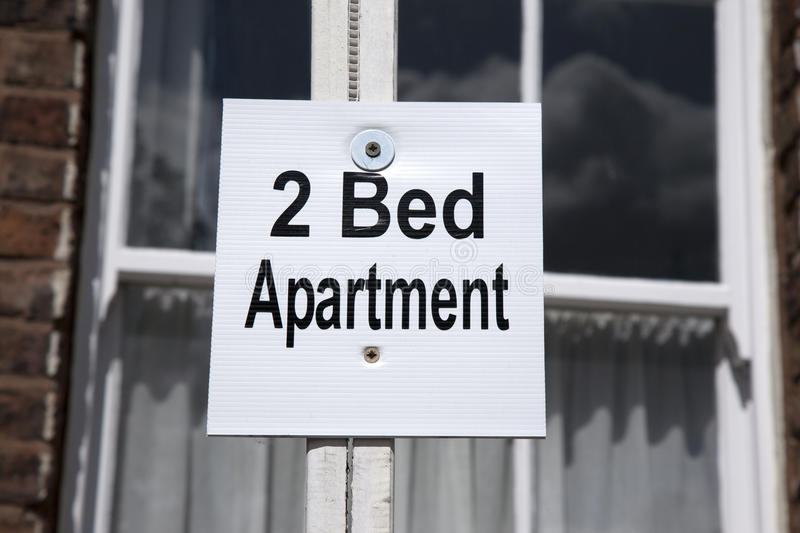 Two Bed Apartment Flat Sign. On Building Facade royalty free stock photos